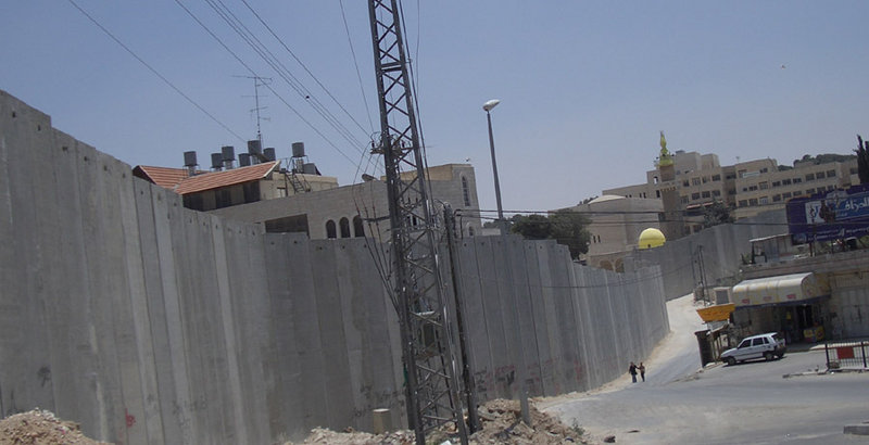 Israeli separation barrier at Abu Dis, June 2004. This picture shows a portion of the barrier being built by Israel in the West Bank.